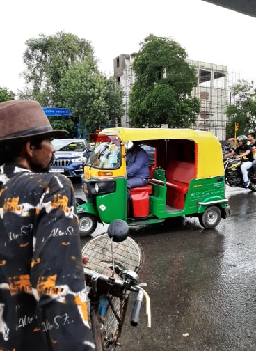 A picture of a normal commute in India with Auto-Rickshaws , motorbikes and cars on the roads, Tourism industry in India
